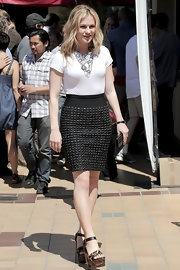 Anna Paquin took a walk on the wild side in Hollywood in a pair of leopard print sandals with wooden platforms. The heavy heels gave her tweed pencil skirt a sexy edge.