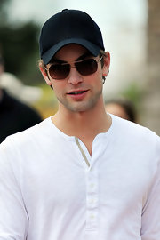 Chace rocked dark brown sunglasses with a black baseball cap at the Beach Bowl in Miami.