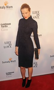 Petra Nemcova's shimmery black clutch gave her embellished black dress a double dose of texture.