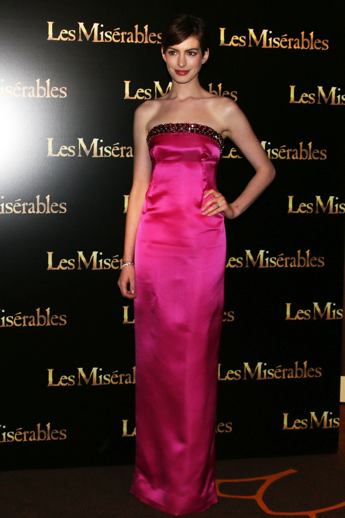 Anne Hathaway and Eddie Redmayne attend the French Premiere of 'Les Miserables' held at Gaumont Marignan in Paris.