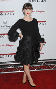 Alexandra Roach teamed her black ensemble with a pair of eye-catching nude and black color-block pumps.