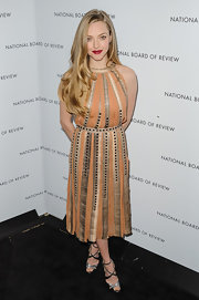 Amanda Seyfried looked like a runway gladiator in this chic orange dress with gold studs.