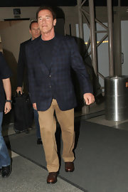 Arnold Schwarzenegger sported a plaid blazer while out traveling at LAX.