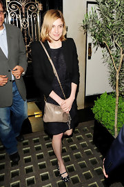 Greta Gerwig accessorized her LBD with a taupe leather shoulder bag during a night out at Scott's Restaurant.