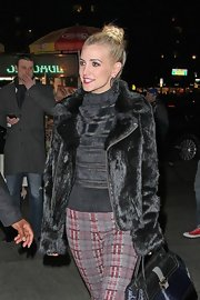 Ashlee was spotted in NYC wearing a furry zip-up jacket and tartan pants.