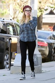 Ashley Benson topped off her look with a maroon knit beanie.