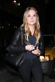 Ashley Benson gave her look a classic finish with a black quilted leather bag.