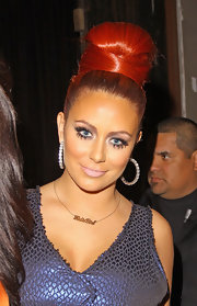 Aubrey O'Day arrived at the Night of a Billion Reality Stars event wearing her hair in a voluminous 60s-inspired bouffant.