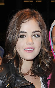 Lucy Hale left her hotel in NYC wearing a pretty pink gloss.