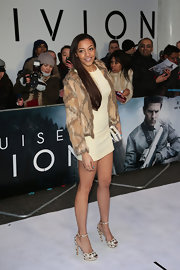 Amal Fashanu chose this cream mini dress paired with a brown patchwork fur coat while at the 'Oblivion' premiere.