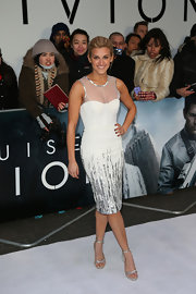 Ashley Roberts stunned in a white frock with a sheer illusion neckline and a silver-sequined skirt.
