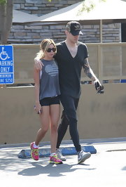 Ashley Tisdale showed off her California style with a gray tank with an American flag heart.