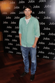 Ashton sported a green gingham button down and jeans at the premiere of 'Jobs' in Paris.