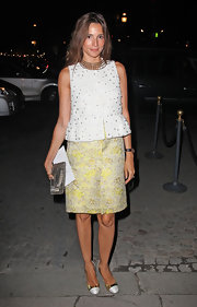 Astrid Munoz added shine to her gorgeous fashion week style with a silver mesh clutch.