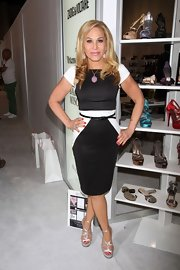A pair of silver strappy sandals added some sexiness to Adrienne Maloof's look.