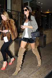 The model wore scrunched suede over the knee boots with silk shorts and a slinky gray jacket.