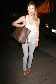 Sophie Monk added a luxe addition to her minimalist street style with a brown checkerboard tote.