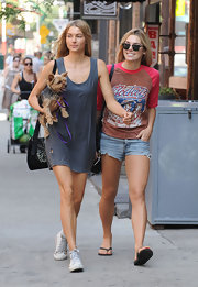 Ashley Hart wore a laid-back ensemble featuring a pair of faded denim shorts and a vintage tee while out with her sister.