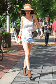 Nicole Trunfio chose a flowing white spaghetti-strap blouse for a sunny stroll in NYC.