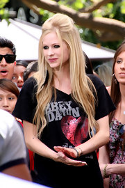 Punk star Avril Lavigne mingled with fans at The Grove in Los Angeles sporting a funky half up-half down look complete with a trendy black feather!