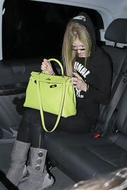 Avril Lavigne put her own spin on a classic with a lime green Hermes Kelly bag.