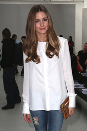 Olivia Palermo contrasted her ripped jeans with an immaculate white button-down when she attended the Veronique Leroy fashion show.