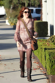 Alyson Hannigan paired her fall-friendly tunic with brown tights and dark brown leather boots complete with buckled detailing.