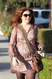 Alyson Hannigan wore a paisley print day dress while visiting her hair salon in LA.