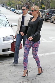 Kristin Cavallari paired her floral pants and black blazer with a pair of classic pumps while out in LA.