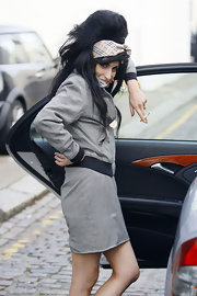 Amy Winehouse wore a Burberry print bandana in her hair with a gray skirt suit.