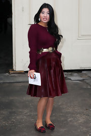 Princess Siriwanwaree wore a cranberry cable-knit sweater with a coordinating skirt for the Chanel show in Paris.