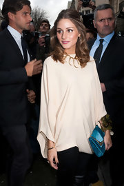Olivia Palermo attended the Christian Dior show in Paris with her hair half up in a small bouffant.