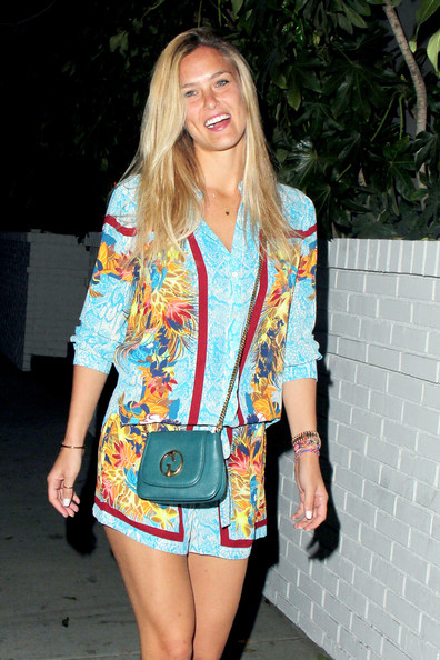 Bar Refaeli looked vibrant and breezy in a colorful print romper during a night out at Chateau Marmont.
