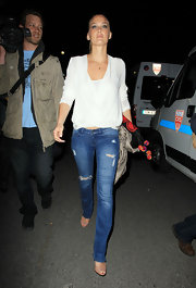 Bar Refaeli was out and about in Cannes wearing a pair of ripped slim-fitting blue jeans and a white blouse.