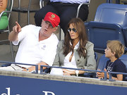 Donald Trump watched the US Open in a red baseball cap.