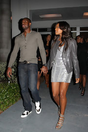 Gabrielle dazzled in a pair of gray Gucci platform sandals. The Venus heels looked perfect with her shimmering cocktail dress and gray leather jacket.