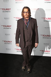 Johnny wears a 3 piece pin stripe suit for this very Depp style.