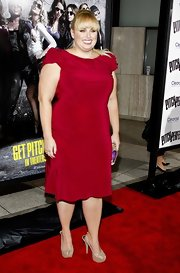 Rebel Wilson paired sparkly gold peep-toe pumps with her radiant red dress.