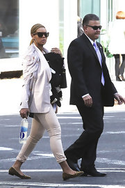 Beyonce Knowles took her daughter for a walk in tight cuffed khakis.