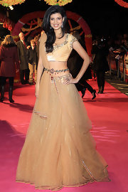 Striking a pose on the red carpet in London, Tena Desae wowed in this striking gold lehenga saree.