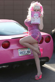 Angelyne flaunted her sexy body in a revealing pink leopard-print mini dress with a sultry peek-a-boo detail on the hip.