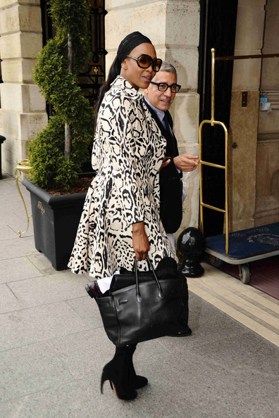 Naomi Campbell headed into The Ritz carrying a black leather Birkin bag stuffed to the brim.
