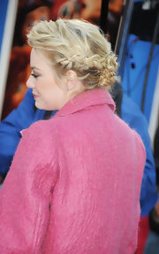 Emma Stone opted for a romantic wavy braided updo for her red carpet look at the 'Croods' premiere.