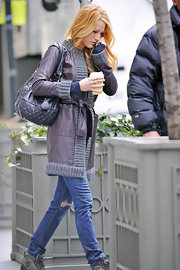 Blake Lively toyed with texture in a purple leather coat with gray knit trim.