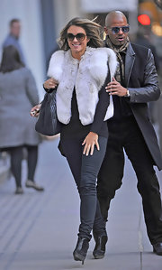 Elizabeth Hurley grinned on the 'Gossip Girl' set in a cropped fur coat with extra fluffy sleeves.