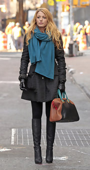 Blake Lively played up her turquoise scarf with an eye-catching color-block bowler bag.