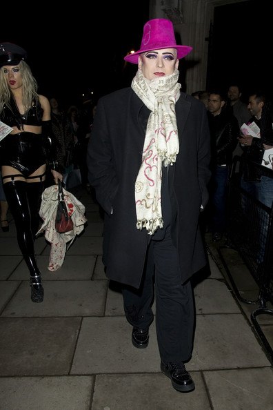 Boy George was all wrapped up in this creamy patterned scarf.