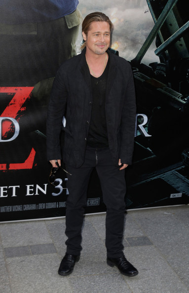 Brad Pitt stuck to an all-black look when he sported a fitted jacket over a tee and jeans.