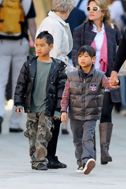 Maddox Jolie-Pitt looked edgy in his black puffer jacket and camouflage pants during a trip to Venice, Italy.