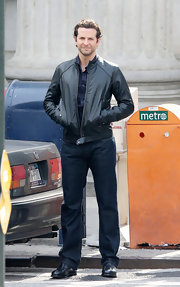 Bradley is in character with this black leather motorcycle jacket.